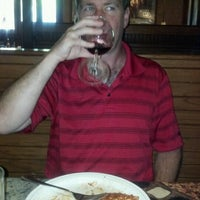 Photo taken at Carrabba's Italian Grill by Carrie E. on 6/16/2012