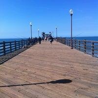 Photo taken at Oceanside Pier by Cheri H. on 3/20/2012