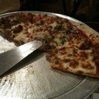 Photo taken at Angelina's Pizzeria & Pasta by Jenny C. on 4/3/2011