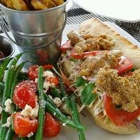 Photo taken at Fish Urban Dining by Corinne C. on 8/26/2012