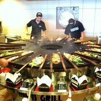 Photo taken at Genghis Grill by Chris W. on 8/18/2011