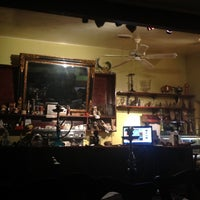 Photo taken at Alhambra Cafe by Ruth K. on 12/28/2011