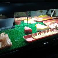 Photo taken at Sushi Redentor by Juliana F. on 8/1/2012
