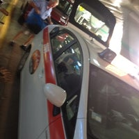 Photo taken at Taxi Stand by Colleen M. on 8/7/2012