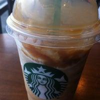 Photo taken at Starbucks by Jidapa K. on 3/11/2012