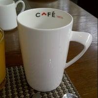 Photo taken at CafeSWISS by Samir P. on 12/18/2011