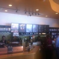 Photo taken at Starbucks by Sarah B. on 3/23/2012