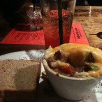 Photo taken at Mick Kelly's Irish Pub by Elise D. on 2/23/2012