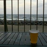 Photo taken at Aqua Restaurant & Bar by Sara S. on 8/25/2012
