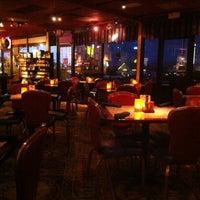 Photo taken at Paymon's Mediterranean Cafe & Hookah Lounge by Wally S. on 8/28/2012