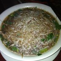 Photo taken at Miss Saigon Cafe by Marc E. on 7/18/2012