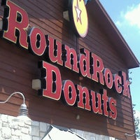 Photo taken at Round Rock Donuts by Julie P. on 8/7/2012