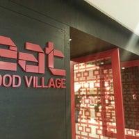 Photo taken at EAT Food Village by Lukas on 6/30/2012