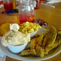 Photo taken at Lo-Lo's Chicken & Waffles by Dshawn C. on 9/25/2011
