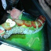 Photo taken at Dragonfly Sushi & Sake Co by Julie G. on 3/18/2012