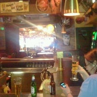 Photo taken at Cigars & Stripes BBQ Lounge by Dale G. on 2/9/2012