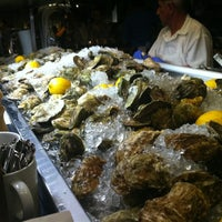 Photo taken at Island Creek Oyster Bar by Mariana F. on 5/23/2012