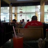 Photo taken at Republic Restaurante by Sarah C. on 1/9/2012