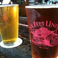 Photo taken at Six Feet Under Pub & Fish House by Shannon H. on 8/6/2012