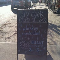 Photo taken at Dry Dock Wine & Spirits by Mina V. on 12/11/2011
