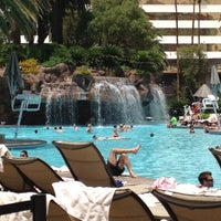 Photo taken at The Mirage Pool & Cabanas by Spencer S. on 5/23/2012
