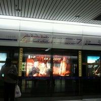 Photo taken at Shanghai Indoor Stadium Metro Stn. by Allen X. on 1/15/2012
