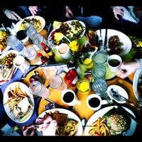 Photo taken at Pick Me Up Café by Adonis S. on 2/12/2012