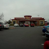 Photo taken at Red Robin Gourmet Burgers by Andrea H. on 12/31/2011