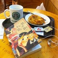 Das Foto wurde bei Starbucks von Donggoo J. am 7/14/2012 aufgenommen