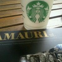 Photo taken at Starbucks by Ligia P. on 12/22/2011