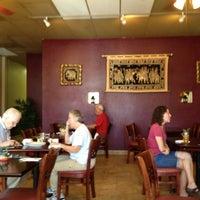 Photo taken at Osha Thai Cafe by Matt M. on 5/10/2012