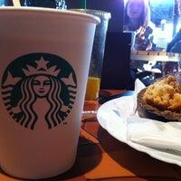 Photo taken at Starbucks by Manuela B. on 3/25/2012