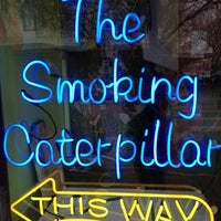 Photo taken at The Smoking Caterpillar by Ashley A. on 2/27/2012
