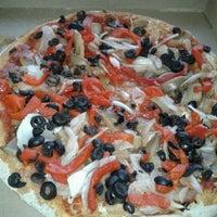 Photo taken at Telepizza by Valeria C. on 1/12/2012