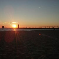 Photo taken at Grand Haven State Park by Kailee H. on 8/21/2012