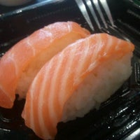 Photo taken at Sushi Sushi by Kenneth C. on 1/2/2012
