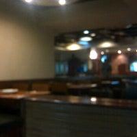Photo taken at Papa John's by Adheeth I. on 10/12/2011