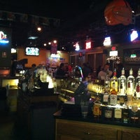 Photo taken at Panini's Bar and Grill by Kevin K. on 12/21/2011