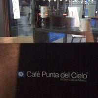 Photo taken at Café Punta del Cielo by Gisela C. on 3/5/2011