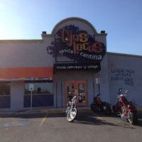 Photo taken at Ojos Locos Sports Cantina by Matt C. on 3/24/2012