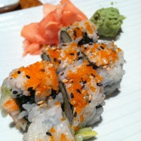 Photo taken at Tsunami Sushi & Hibachi Grill by Melanie L. on 5/27/2012