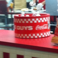 Photo taken at Five Guys by Ross A. on 12/31/2010