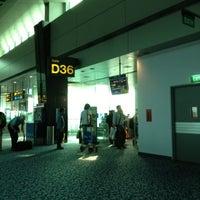 Photo taken at Gate D36 by Sarawut P. on 8/17/2012