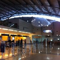 Photo taken at Aeropuerto Presidente Carlos Ibáñez del Campo (PUQ) by Nelson G. on 3/8/2012