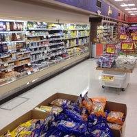 Photo taken at Plumb's Supermarket by Aaron J. on 2/20/2012