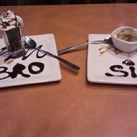 Photo taken at Boston's Restaurant & Sports Bar by Isaiah on 12/19/2011
