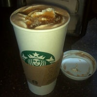 Photo taken at Starbucks by victor p. on 10/4/2011