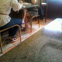 Photo taken at Republic Restaurante by Sarah C. on 1/6/2012