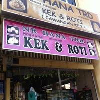 Photo taken at Kek & Roti NR Hana by Farhan I. on 8/18/2012