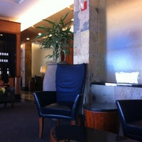 Photo taken at Delta Sky Club by Brad L. on 5/8/2012